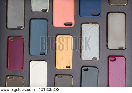 Pile Of Multicolored Plastic Back Covers For Mobile Phone. Choice Of Smart Phone Protector Accessori