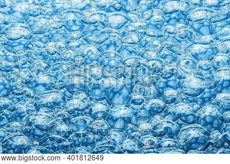 Blue Foam Background. Soap Bubble Structure. Closeup Washing Suds Texture. Bright Bubbles Pattern.