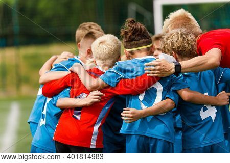 Group Of Children Huddling With Coach. Youth Soccer Football Team Group Photo. Kids Playing Team Spo