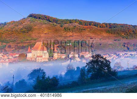 Biertan, Romania. Transylvanian Touristic Village With Saxon Fortified Church In The Morning Light.