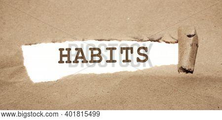 Habits Word Under Brown Torn Paper. Addiction Prevention Bad Habits Concept