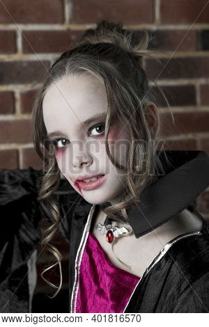 A Beautiful Woman, A Vampire. Halloween Beauty, Makeup And Jewelry, Girl In A Vampire Costume