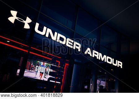 Milan, Italy - 17.12.2020. Under Armour Logo Signboard Of The Store. Under Armour Is An American Spo