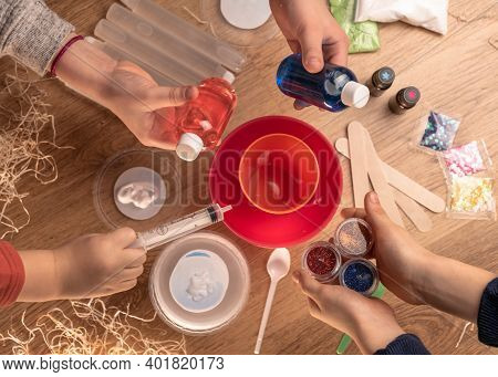 Kids Hands Making Slime Toy At Home