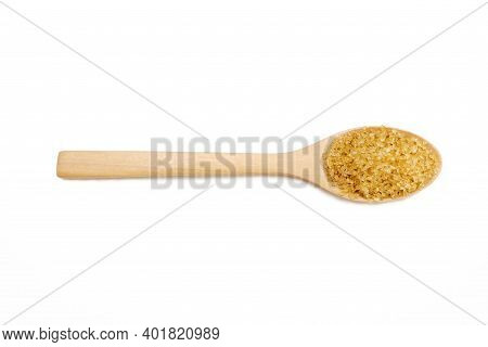 Brown Sugar Placed In A Wooden Spoon, Food Concept.  Backdrop Isolated On White Background.