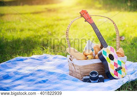 Happy Family Picnic Concept. Picnic Wattled Basket With Full Bread And Banana Put The Place On A Pic