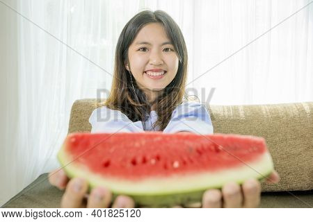 Asian Women Are Eating Watermelon, For Refreshing In The Hot Atmosphere.