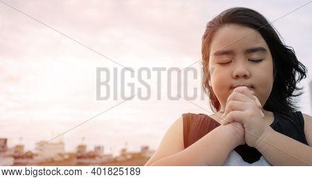 Little Girl Praying In The Morning.little Asian Girl Hand Praying,hands Folded In Prayer Concept For