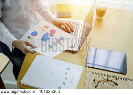 Businessman Analyzing Investment Charts With Laptop. Working With Financial Graphs Charts Online, Us