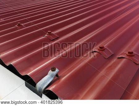 Background Of Red Corrugated Sheet Metal. Sheet Metal Roof Or Corrugated Roofs Of Factory Or Warehou
