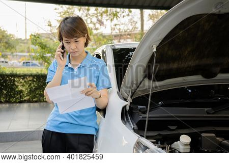 Women Who Are Experiencing Problems Due To The Accident Of Her Car. She Is Reviewing The Insurance D