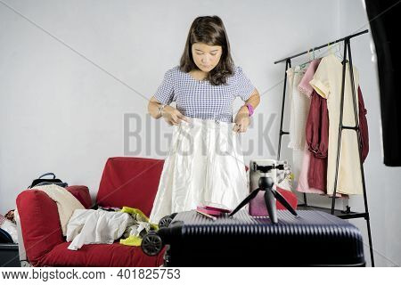 Starting An Online Sales Business, Cute Asian Woman, She Is Starting To Sell Clothes Online. In Whic