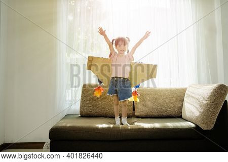 Child Pretend To Be Businessman. Kid Playing At Home. Imagination, Idea And Creative Concept. The Gi