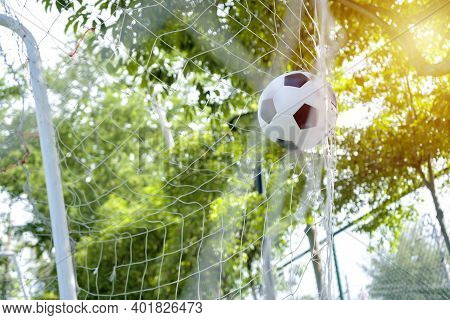 Business Goals Concept. The Purpose Of Doing Business Is To Achieve Success. The Soccer Ball Entered