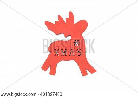 Red Color Wooden Christmas And New Year Deer With The Xmas Inscription, A Conceptual Symbol Of The W