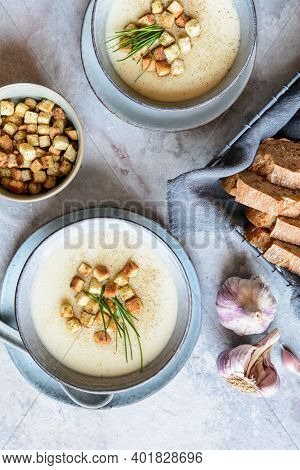 Creamy Garlic Soup Topped With Croutons And Chives