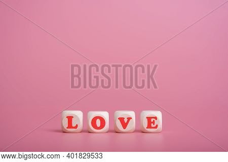 Text Wooden Blocks Spelling The Word Love On Pink Background