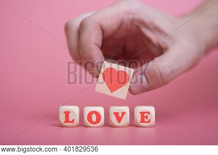 Love Valentine's Day Conceptman Hand Holding Heart, On Pink Background.