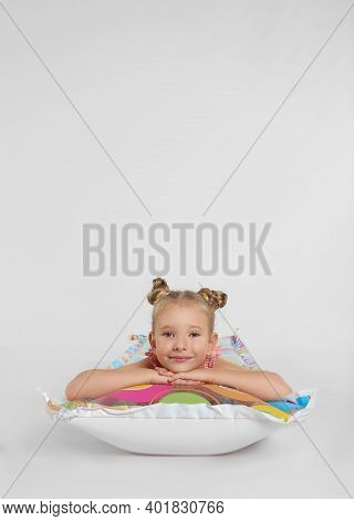 Cute Little Child In Beachwear With Bright Inflatable Mattress On White Background