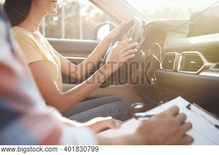Young Woman In Car With Instructor, Closeup. Driving School