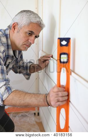 Man using a spirit level