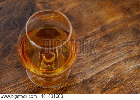 Brandy Snifter Glass Of Alcohol Drink On Wooden Table