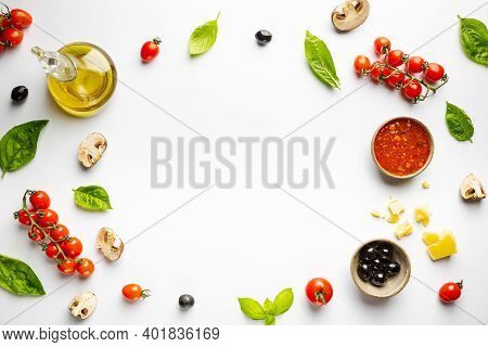 Food Ingredients And For Cooking Delicious Italian Pizza On White Background. Copy Space. Top View.