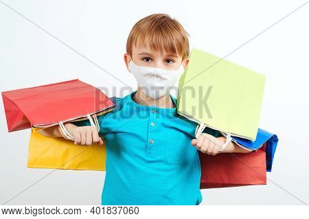 Boy In Protective Face Mask Holding Shopping Bags. Young Shopaholic With Paper Bags. Seasonal Sales
