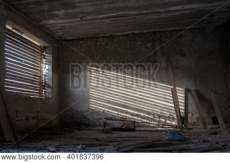 An Abandoned Building, An Old People's Home With Boarded-up Windows. The Geometry Of Sunlight And Th