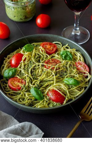 Pasta Spaghetti With Pesto Sauce, Tomatoes And Basil. Healthy Eating. Vegetarian Food.