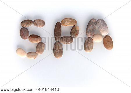 Pebbles On White Background, Sea Pebble. Inscription, Text, Word: Spa. Concept