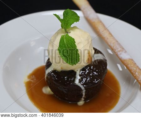 Sticky Toffee Pudding With Vanilla Ice Cream And Caramel Sauce