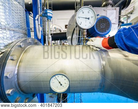 Employee Hand At Pressure Gauge On Chrome Steel  Pipe. Temperature Gauge At Flange, Gate Valves And