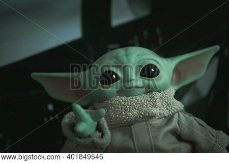 DEC 28 2020: portrait of Jedi Grogu from Disney Plus series The Mandalorian (baby Yoda) - Mattel 11 inch plush toy