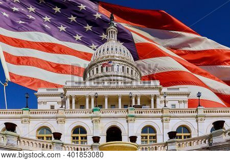 The Us Capitol Building Dome In Washington Dc With American Flag