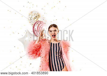 Funny Woman Celebrating With Air Balloons Isolated White. Shows Hand Okay. In Pink Fur Coat, Golden