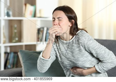 Stressed Woman With A Stomach Ache About To Vomit On A Couch At Home