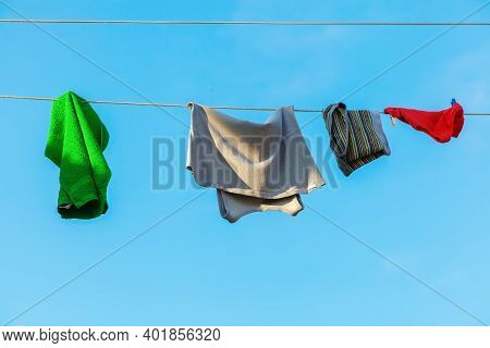 Picture Of Clothes And Towel Hanging On A Clothesline