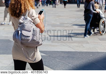 Woman With Handbag And Phone On The Move In The City