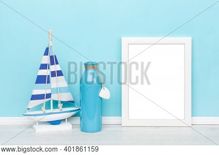 Maritime artwork background mockup with white picture frame, sail boat and vase in front of turquoise wall, image area isolated with clipping path for ease of use