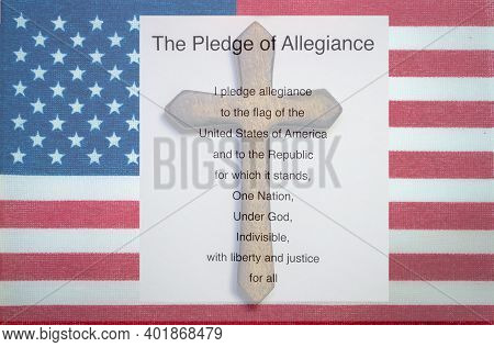The Stars And Stripes Flag Of The United States Flies The Frame With An Overlay Of The Pledge Of All