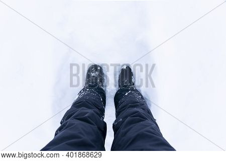 Snowy Boots. Top View Of Shoes Or Boots Footprint In Fresh Snow. Winter Season. Focus On Legs. High