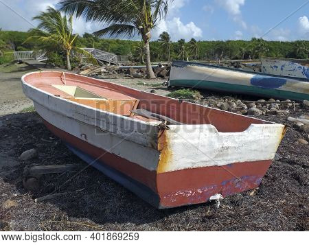 Old Fishermen Boats Stranded On The Caribbean Coast In A Natural Tropical Environment. Old Wrecked B