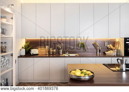 Modern Interior With White Kitchen Cupboards Over Wooden Countertop, Food Ingredient On Surface Near