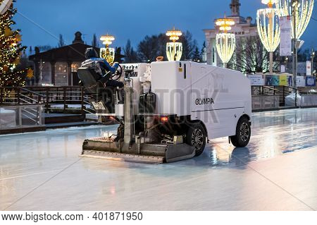 Moscow, Russia - November 29, 2020: Ice Resurfacer In Action At The Vdnkh Park Ice Rink. Ice Polishi