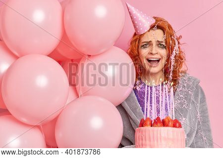 Photo Of Frustrated Redhead Woman Cries From Despair Has Bad Mood After Partying Celebration Holds B