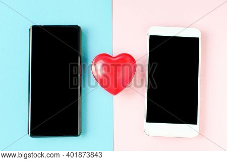 Valentines Day Coronavirus Two Phones And A Heart. Covid 19 Valentine. Online Communication, Virtual