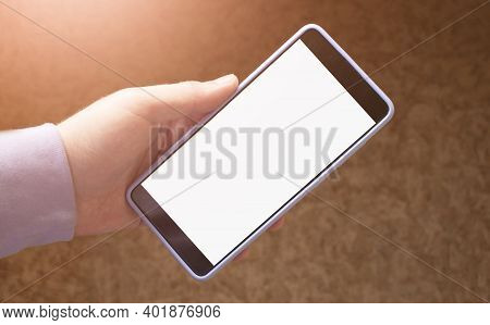 Man Using Mobile Smart Phone With Blank White Screen