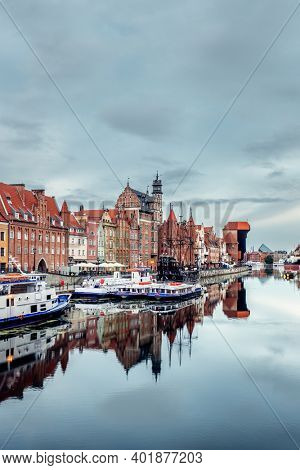 Cityscape of Gdansk old town on the river Motlawa at cloudy day. Old Town of Gdansk, Poland.