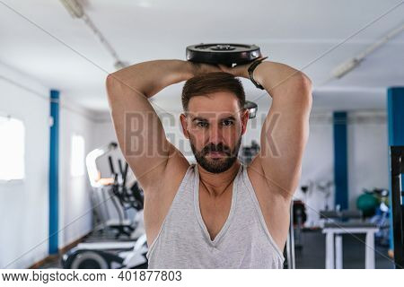 Man Training Dumbbell Triceps. Sport. Strong. Triceps